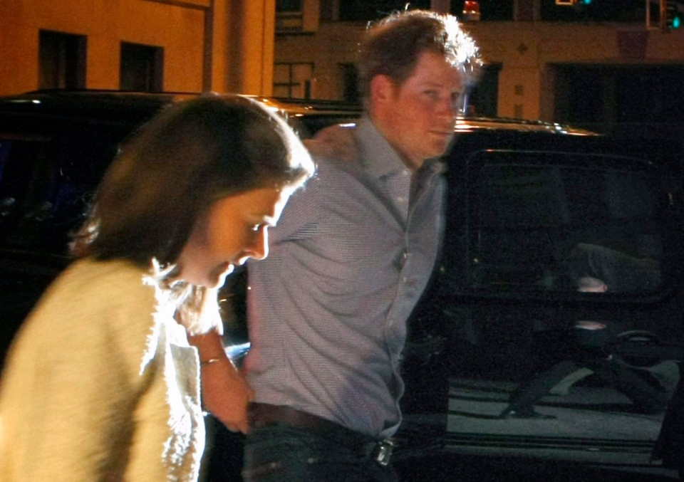 Britain's Prince Harry steps out of a vehicle to eat at Rendezvou in downtown Memphis, Tenn. in this photo taken Thursday, May 1, 2014.  (The Commercial Appeal / Karen Pulfer Focht)
