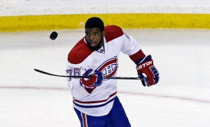 Montreal Canadiens defenseman P.K. Subban flips the puck prior to facing the Boston Bruins in Game 2 in the second-round of a Stanley Cup hockey playoff series in Boston, Saturday, May 3, 2014. (AP / Charles Krupa)