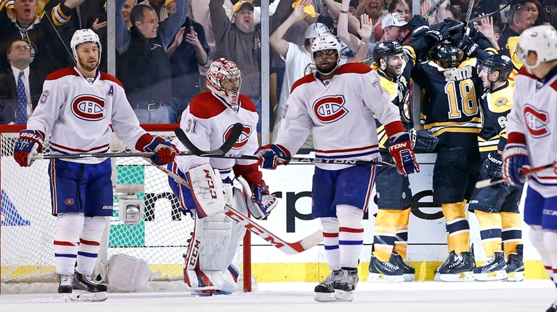 Montreal Canadiens defenseman Josh Gorges (26), goalie Carey Price (31) and defenseman P.K. Subban (76) react as fans celebrate with Boston Bruins right wing Reilly Smith (18), center Patrice Bergeron (37) and Brad Marchand (63) after Smith's goal during the third period in Game 2 of an NHL hockey second-round Stanley Cup playoff series against the Montreal Canadiens in Boston, Saturday, May 3, 2014. The Bruins won 5-3 to even the best-of-seven games series at one game apiece. (AP Photo/Elise Amendola)