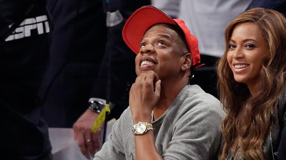 Recording artists Beyonce, right, and Jay-Z watch during the first half of Game 6 of the opening-round NBA basketball playoff series between the Brooklyn Nets and the Toronto Raptors, Friday, May 2, 2014, in New York. (AP Photo/Frank Franklin II)