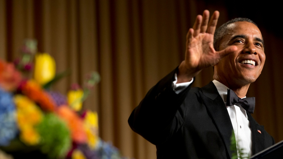 President Barack Obama gestures and smiles during his speech at the White House Correspondents' Association (WHCA) Dinner at the Washington Hilton Hotel, in Washington, Saturday, May 3, 2014. (AP / Jacquelyn Martin)