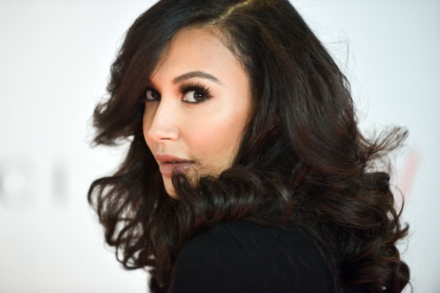 Naya Rivera arrives at the 22nd Annual Women in Entertainment Breakfast in Beverly Hills, Calif., on Dec. 11, 2013. (Richard Shotwell / Invision / AP)