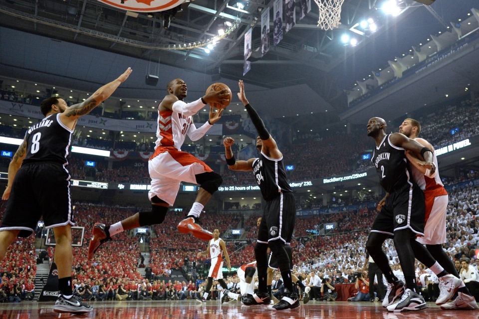 Toronto Raptors' Terrence Ross (31) drives to the net against Brooklyn Nets' Deron Williams (8) and Paul Pierce (34) as Nets' Kevin Garnett (2) boxes out Raptors' Jonas Valanciunas during first half NBA game seven playoff basketball action in Toronto on Sunday, May 4, 2014. (Frank Gunn / THE CANADIAN PRESS)