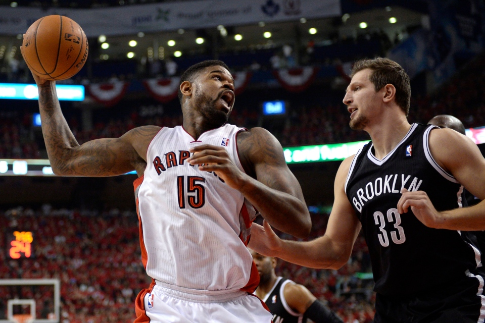 Toronto Raptors' Amir Johnson, left, works against Brooklyn Nets' Paul Pierce during first half NBA game seven playoff basketball action in Toronto on Sunday, May 4, 2014. (Frank Gunn / THE CANADIAN PRESS)