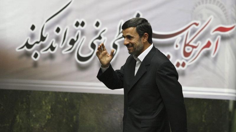 Iranian President Mahmoud Ahmadinejad is seen waving in the Iranian parliament on Nov. 1, 2011