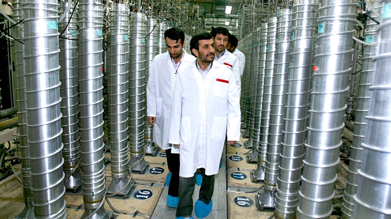 Iranian President Mahmoud Ahmadinejad, center, visits the Natanz Uranium Enrichment Facility some 322 kilometres south of the capital, Tehran, Iran on Tuesday, April 8, 2008. (AP / Iranian President's Office)