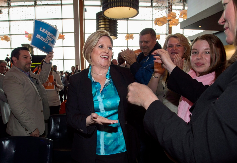 Ontario NDP Leader Andrea Horwath greets supporters after being nominated to represent Hamilton Centre in the upcoming provincial election during an NDP rally in Hamilton, Ont., Saturday, May 3, 2014. (Darren Calabrese / THE CANADIAN PRESS)