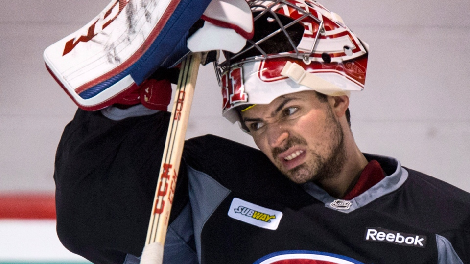 Montreal Canadiens goalie Carey Price slips on his face mask during a practice Wednesday, April 30, 2014 in Brossard, Que. (THE CANADIAN PRESS / Paul Chiasson)