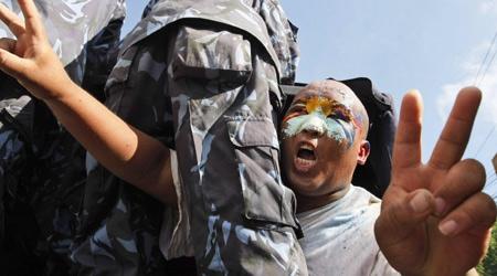 A detained Tibetan exile protestor shouts slogans near the Chinese Embassy in Katmandu, Nepal, Friday, Aug. 8, 2008. (AP / Binod Joshi)
