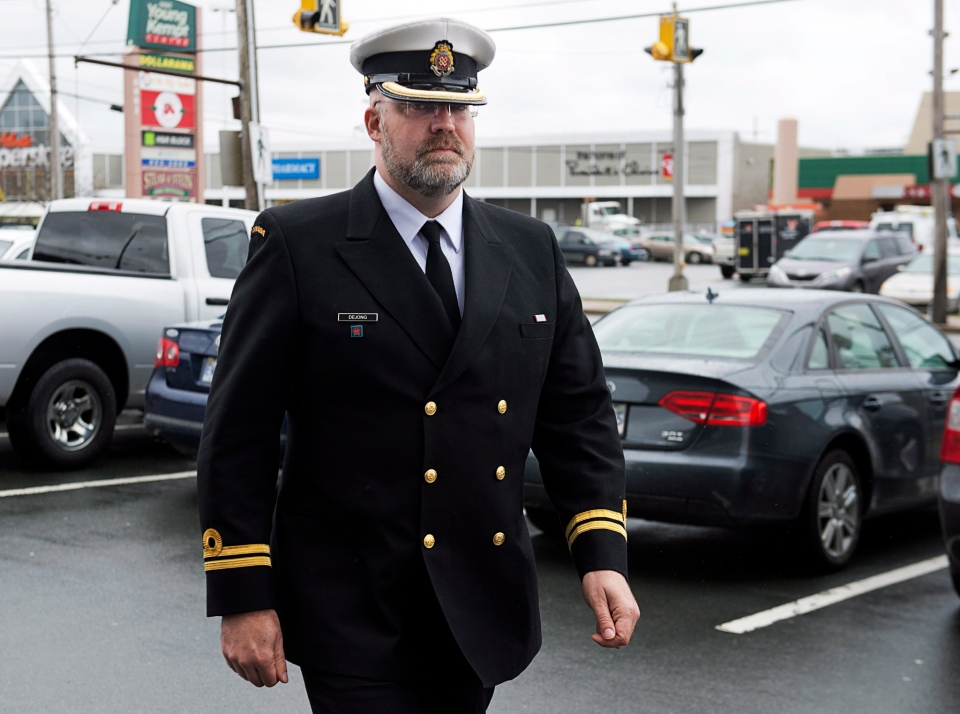 Lt. Derek De Jong arrives at his court martial in Halifax on Monday, May 5, 2014. (Andrew Vaughan / THE CANADIAN PRESS)
