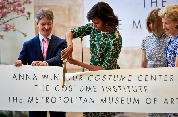 Michelle Obama cuts the ribbon.