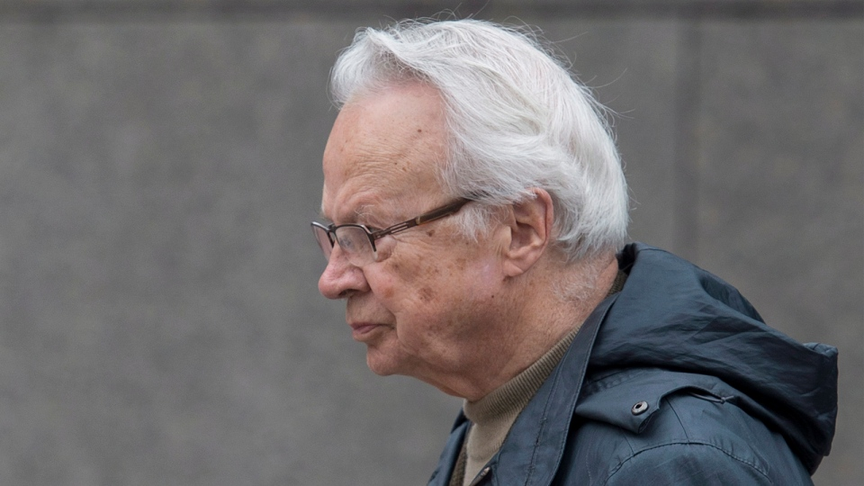 Former Liberal organizer Jacques Corriveau leaves the Montreal Courthouse, Monday, May 5, 2014, where he faces charges related to the federal sponsorship scandal. (Graham Hughes / THE CANADIAN PRESS)