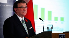 Minister of Finance Jim Flaherty responds to a question during question period in the House of Commons on Parliament Hill in Ottawa