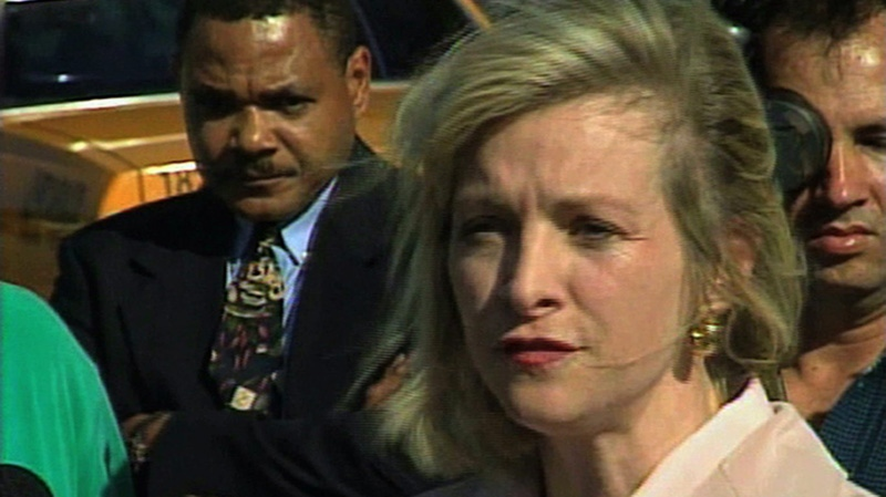 This March 2000 image from video shows then-Immigration and Naturalization Service spokesperson Karen Kraushaar at a news conference in Miami regarding Elian Gonzalez. (APTN)