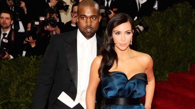 Kanye West, left, and Kim Kardashian attend The Metropolitan Museum of Art's Costume Institute benefit gala celebrating 'Charles James: Beyond Fashion' on Monday, May 5, 2014, in New York. (Charles Sykes / Invision)