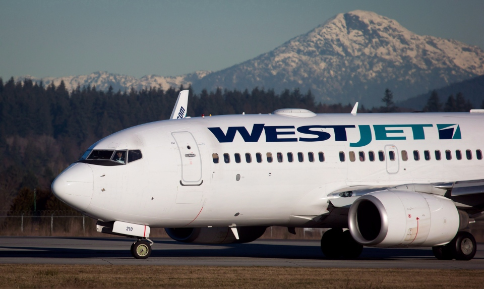 A pilot taxis a Westjet Boeing 737-700 plane to a gate after arriving at Vancouver International Airport in Richmond, B.C., on Monday February 3, 2014. (Darryl Dyck / THE CANADIAN PRESS)