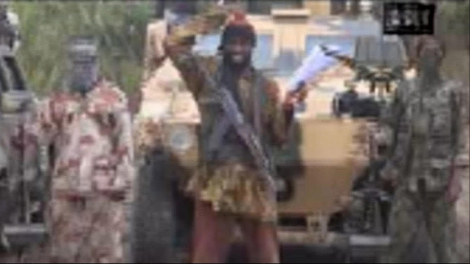 In this image made from video received by The Associated Press on Monday, May 5, 2014, Abubakar Shekau, the leader of Nigeria's Islamic extremist group Boko Haram, speaks in a video in which his group claimed responsibility for the April 15 mass abduction of nearly 300 teenage schoolgirls in northeast Nigeria.