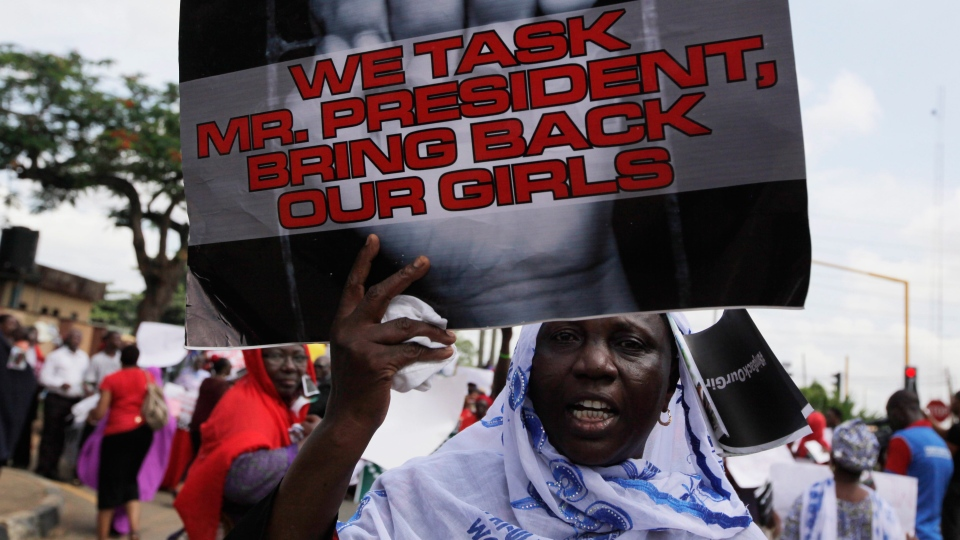 A women attend a mass-demonstration calling on the government to increase efforts to rescue the hundreds of missing kidnapped school girls of a government secondary school Chibok, in Lagos, Nigeria, Monday, May 5, 2014. (AP / Sunday Alamba)
