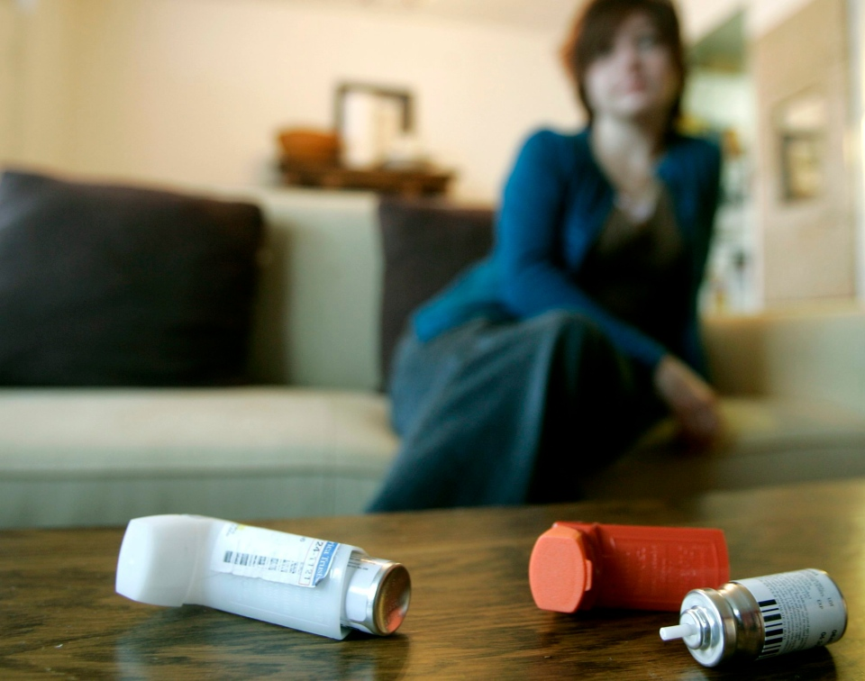 Shelley MaKay looks over her inhalers at her apartment on Monday, March 13, 2006 in Toronto, Ont. (Nathan Denette / THE CANADIAN PRESS CP PHOTO)