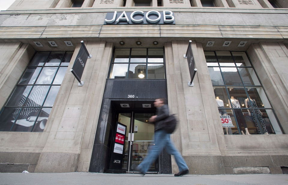 A man walks by a Jacob clothing store in Montreal on Tuesday, May 6, 2014. (Graham Hughes / THE CANADIAN PRESS)