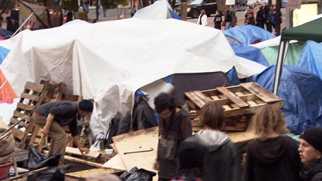 Occupy Vancouver protesters clear out tarps and other fire hazards to comply with a court order. Nov. 9, 2011. (CTV)