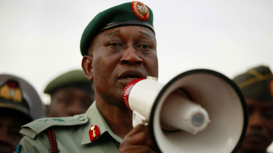 Brig. Gen. Chris Olukolade, Nigeria's top military spokesman, speaks to people at a demonstration calling on the government to rescue the kidnapped school girls from the Chibok government secondary school, outside the defense headquarters, in Abuja, Nigeria, Tuesday May 6, 2014. (AP Photo/Sunday Alamba)