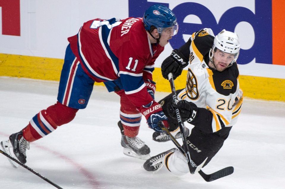 Boston Bruins' Daniel Paille is dumped by Montreal Canadiens' Brendan Gallagher during second period NHL playoff hockey action Tuesday, May 6, 2014 in Montreal. (Paul Chiasson / THE CANADIAN PRESS)