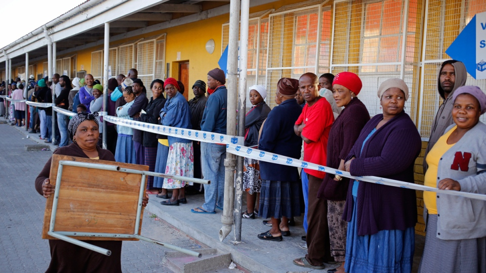 People stand in line to vote during elections in the township of Nyanga on the outskirts of Cape Town, South Africa, Wednesday, May 7, 2014. (AP / Schalk van Zuydam)
