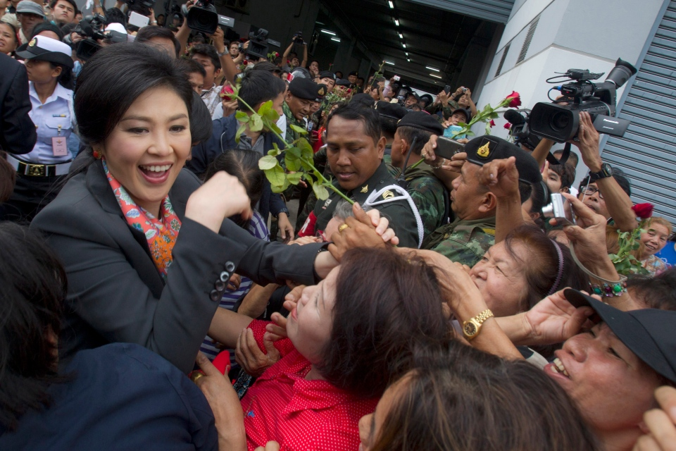 Thai Prime Minister Yingluck Shinawatra shakes hands with her supporters in Bangkok, Thailand, Wednesday, May 7, 2014. (AP / Sakchai Lalit)