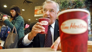 Tim Hortons co-founder Ron Joyce sips a coffee in Toronto on Friday, October 20, 2006. (File / THE CANADIAN PRESS)