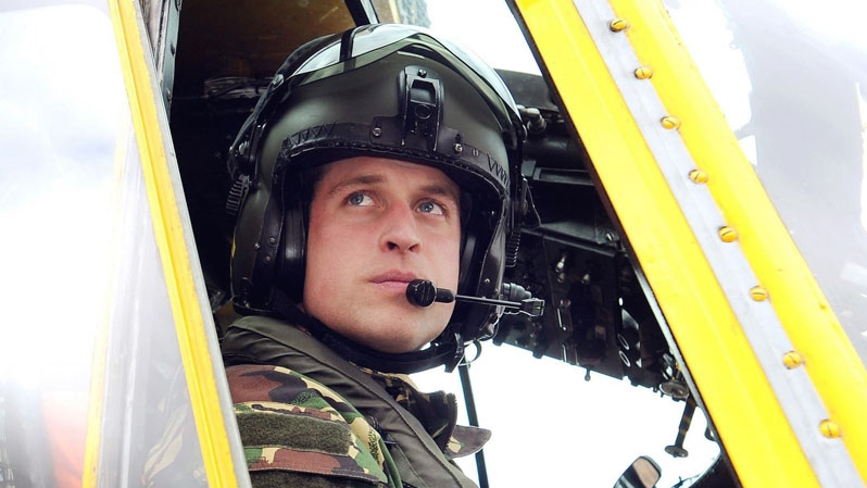 Britain's Prince William, the Duke of Cambridge, is seen at the controls of a Sea King helicopter on March 31, 2011. (AP / John Stillwell, PA)