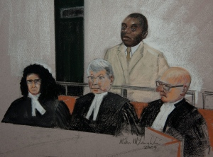 This photo of a sketch show Desire Munyaneza as he stands to hear the Quebec court decision that he is guilty of seven charges against him in Montreal on Friday, May 22, 2009. (THE CANADIAN PRESS/Mike Mclaughlin)