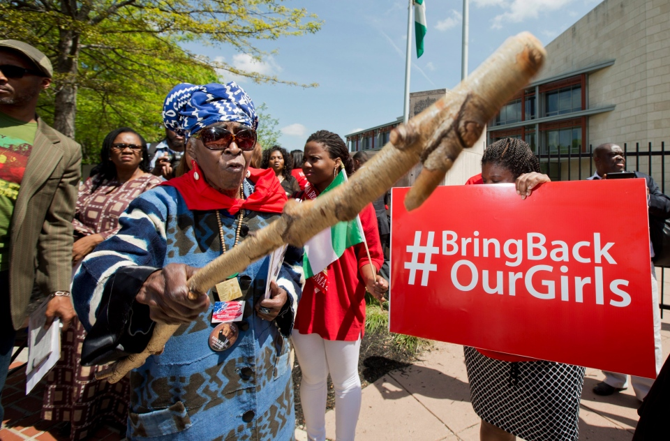 Mia Kuumba, of the District of Columbia, brandishes a wooden stick during a rally in front of the Nigerian embassy in northwest Washington, Tuesday, May 6, 2014. (AP / Manuel Balce Ceneta)