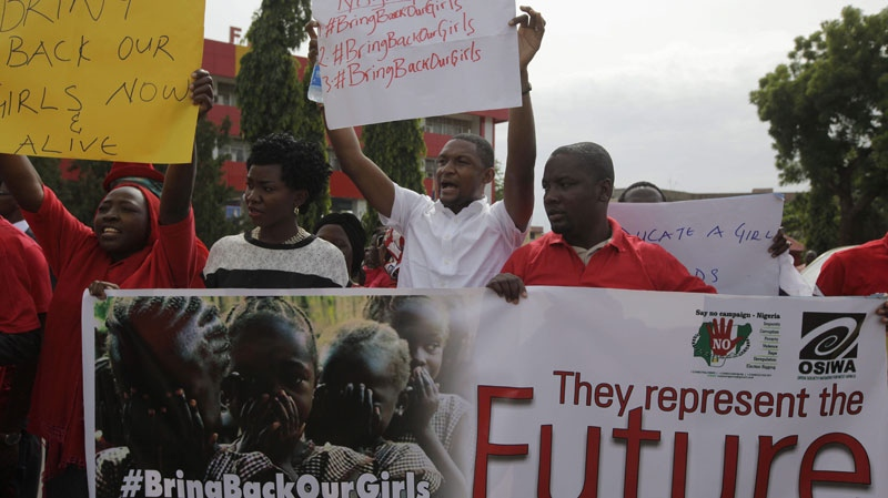 People attend a demonstration calling on the government to rescue the kidnapped school girls of a government secondary school Chibok, outside the defense headquarters in Abuja, Nigeria, Tuesday May 6, 2014. (AP / Sunday Alamba)