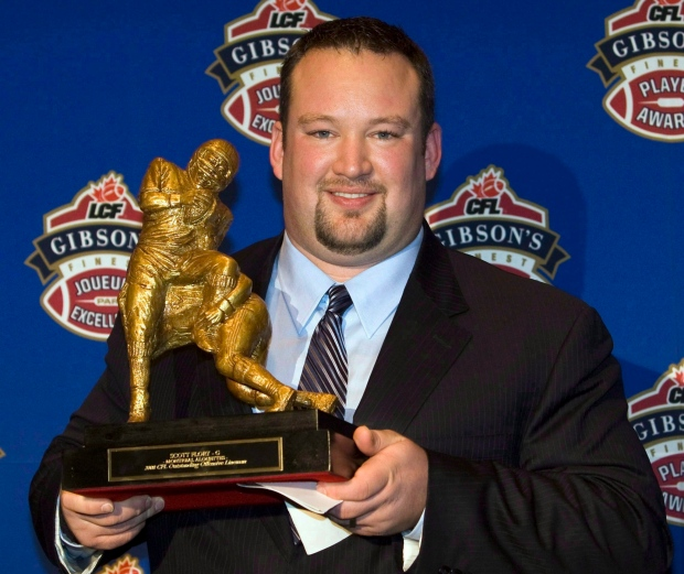 Scott Flory holds CFL trophy