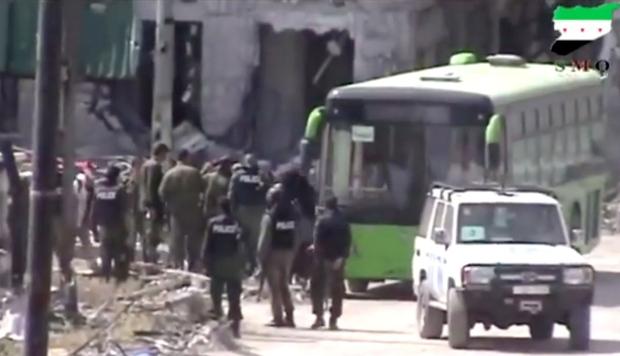 Rebels evacuate last bastions in Homs, Syria