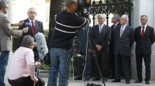 The new Greek Prime Minister Lucas Papademos, standing 2nd left, makes statements outside the presidential palace in Athens, Thursday, Nov. 10, 2011. (AP / Petros Giannakouris)