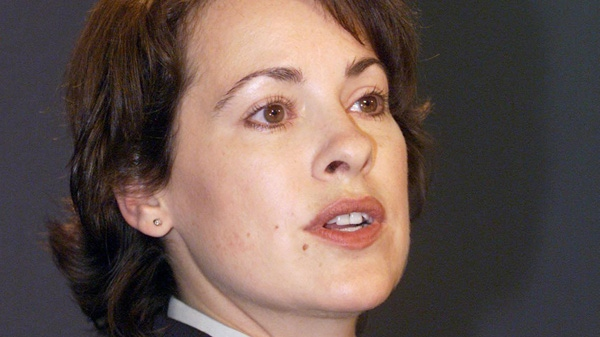 Cpl. Catherine Galliford is shown answering a reporters' question during a media briefing in Vancouver on Thursday, Sept. 19, 2002. Galliford says the RCMP is accountable to no one for the treatment of its employees and a union or similar organization is needed to protect them from a culture that is badly broken.  (Richard Lam / THE CANADIAN PRESS)