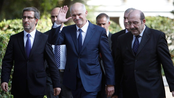 Outgoing Prime Minister George Papandreou waves to the media as he leaves the presidential palace in Athens, Thursday, Nov. 10, 2011.  (AP / Thanassis Stavrakis)
