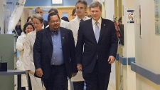 Prime Minister Stephen Harper, right, chats with Dr. Arthur Porter, left, at the Montreal General hospital in Montreal Friday Nov.24, 2006. (CP PHOTO/Ryan Remiorz) Canada