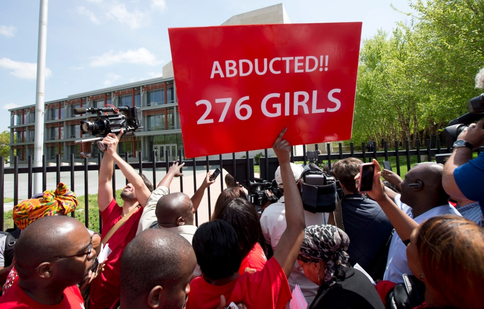 Protestors crowd the gate of the Nigerian embassy in northwest Washington, Tuesday, May 6, 2014, protesting the kidnapping of nearly 300 teenage schoolgirls, abducted from a school in the remote northeast of Nigeria three weeks ago. (AP / Manuel Balce Ceneta)
