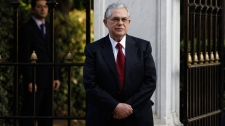 New Greek Prime Minister Lucas Papademos stands after his statements outside the presidential palace in Athens, Thursday, Nov. 10, 2011.  (AP / Thanassis Stavrakis)