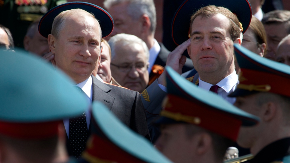 Russian President Vladimir Putin, left, and Prime Minister Dmitry Medvedev, right, take part in the wreath laying ceremony at the Tomb of Unknown Soldier at the Kremlin wall in Moscow, Russia, on Thursday, May 8, 2014. (AP / Ivan Sekretarev)