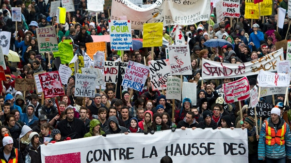 Thousands of CEGEP and university students march the streets of Montreal to demonstrate against hikes in tuition fees Thursday, November 10, 2011 in Montreal. THE CANADIAN PRESS/Paul Chiasson