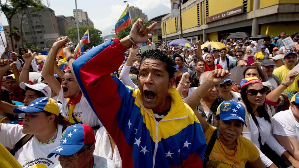 Students shout slogans against Venezuela's President Nicolas Maduro during a May Day march in Caracas, Venezuela, Thursday, May 1, 2014. (AP / Fernando Llano)