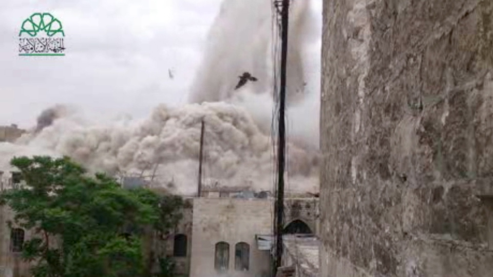 This image made from amateur video posted by Shaam News Network (SNN), an anti-Bashar Assad activist group, which has been verified and is consistent with other AP reporting, shows an explosion that destroyed the Carlton Hotel in Aleppo, Syria, Thursday, May 8, 2014. (AP / Shaam News Network via AP video)