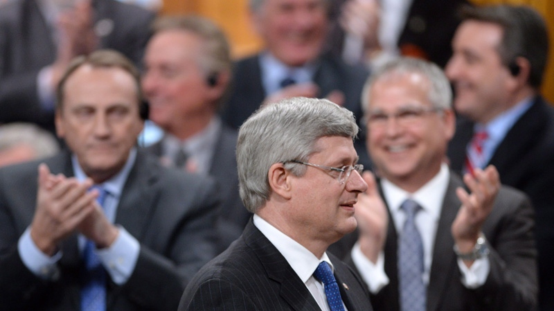 Prime Minister Stephen Harper is applauded by MPs during question period in the House of Commons on Parliament Hill in Ottawa on Tuesday, February 25, 2014. (Sean Kilpatrick / THE CANADIAN PRESS)