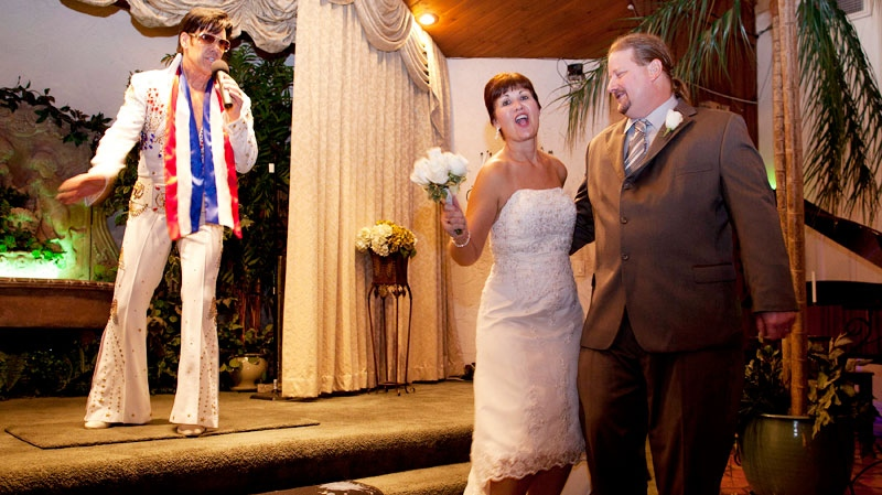 Paul, right, and Kim Deaton, of Lake Station, Ind., dance at the end of their wedding ceremony at the Viva Las Vegas Wedding Chapel as chapel owner and Elvis impersonator sings, Friday, Nov. 11, 2011, in Las Vegas. (AP / Julie Jacobson)