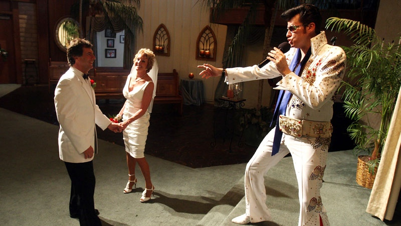 Brian Mills, left, an Elvis impersonator, marries Richard Johnson and Cheryl Bell of Peoria, Ariz. at the Viva Las Vegas wedding chapel Wednesday, Sept. 9, 2009 in Las Vegas. (AP Photo/Isaac Brekken)