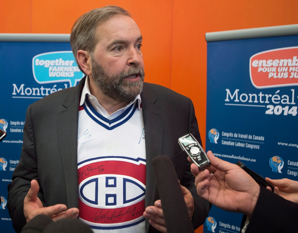 NDP Leader Thomas Mulcair answers reporters' questions following his speech to delegates at the Canadian Labour Congress in Montreal, Thursday, May 8, 2014. (Graham Hughes / THE CANADIAN PRESS)